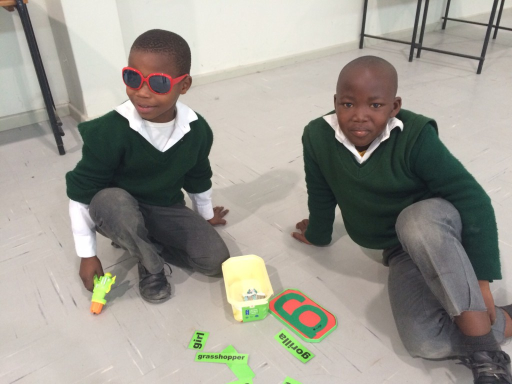 children sounding letter using sound boxed