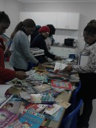 teachers selecting books from books colletion